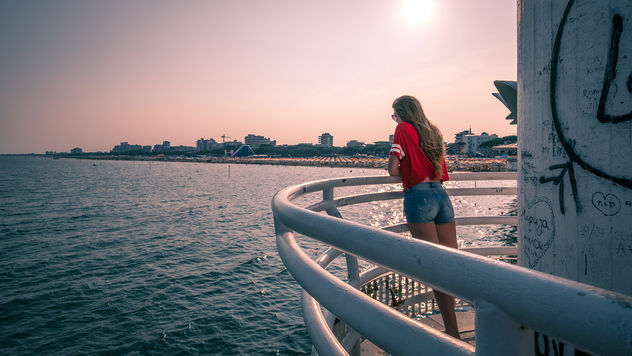 The girl in red - Lignano sabbiadoro, Italy - Color street photography - Free image #446807