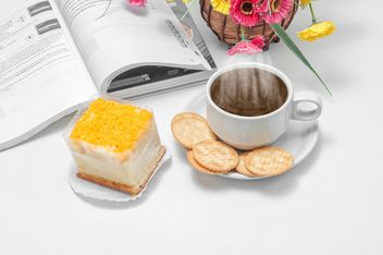Cup of coffee with crackers, dessert and book - image #452437 gratis