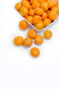 oranges in white plate on white background - Free image #452517