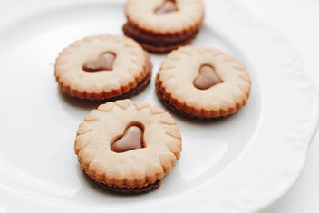Close up of group of biscuits with chocolate hearts - image #452637 gratis