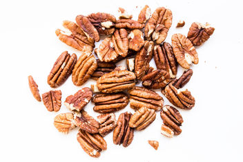 Close up of raw pecan nuts on white background.jpg - image #458247 gratis