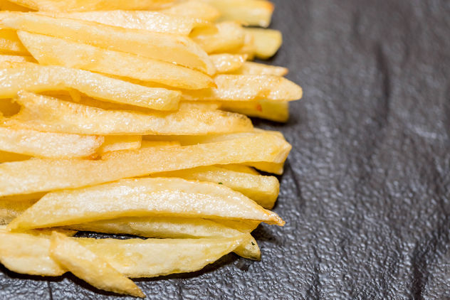 French-fries-on-black-background.jpg - бесплатный image #458277