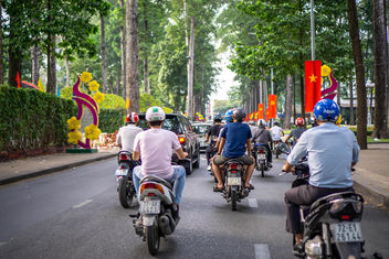 Vietnamese Flags and Tet Decorations along a Street in Saigon, Vietnam - image #458757 gratis